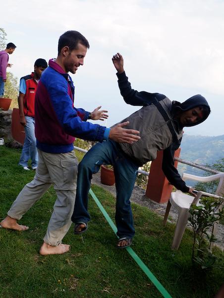 Victor (France) helping Prakash on the slack wire!