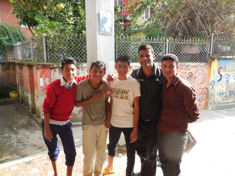 Suraj pictured with the boys and Housefather of Annapurna in 2013.